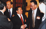Chairman of the Standing Committee of the National People's Congress Wu Bangguo cordially receiving Chairman of the Board of Directors Wu Zhenshan